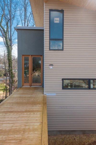 Asheville Design Economy Credits  Architecture: Rusafova Markulis Architects, Mountain Sun Builders General Contractor: Mountain Sun Builders Photo  of Shelburne Woods modern home