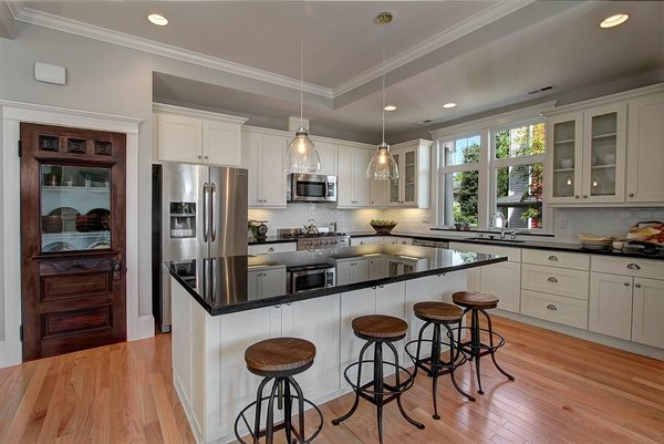 The door to the pantry adjacent to the kitchen was one of the original doors in the house that we were able to reuse and re-purpose. While the entire house has been updated, there are many nods to the original home. Photo 2 of Madrona Victorian modern home