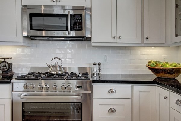 The kitchen has been completely redone to keep up with the modern lifestyle of the owners. Photo 6 of Madrona Victorian modern home