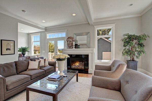 The living room is a comfortable space with gorgeous double hung windows that take advantage of the beautiful view of the outside. Photo 7 of Madrona Victorian modern home
