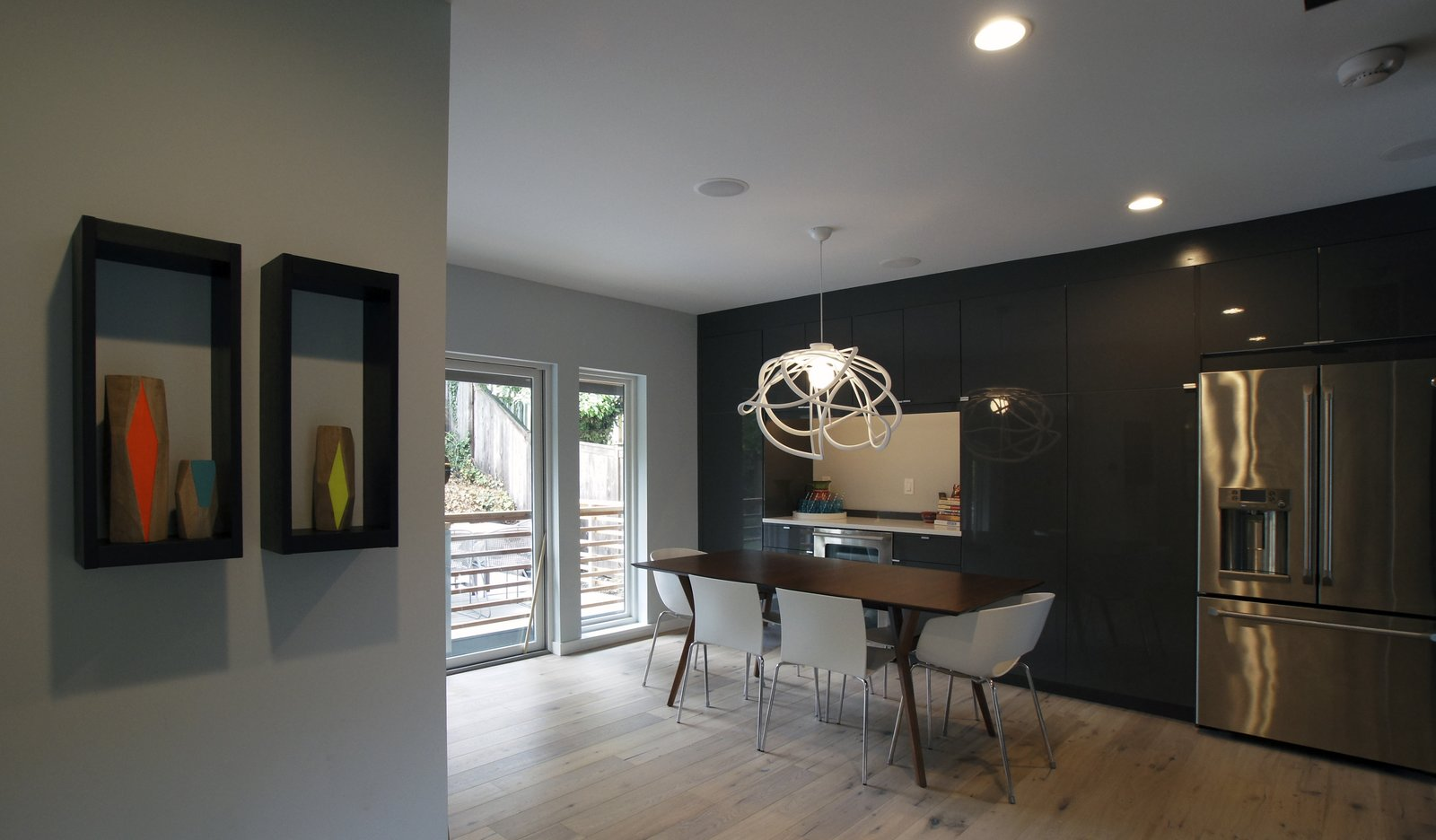 The dining room is essentially an extension of the kitchen, providing ample space for entertaining without feeling too cavernous when the family is eating without company.