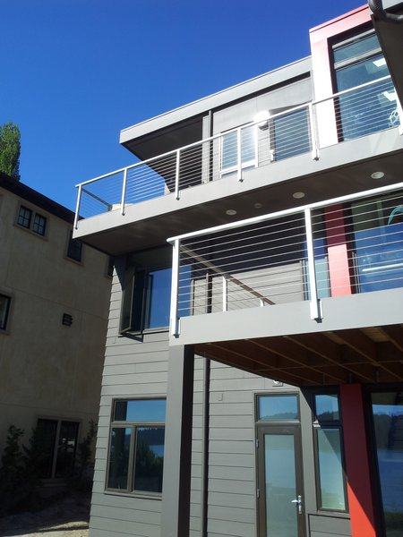 This modern home uses color and pattern to help distinguish the variations in form and provide views of the lake from all rooms. Photo  of Lake Washington Home modern home