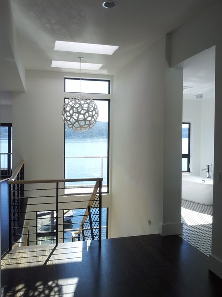 This third story master suite is completely open from stair to master bedroom and master bath. Photo 3 of Lake Washington Home modern home