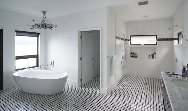 This black and white bathroom is open to the master suite as well as the deck and view beyond. Photo 4 of Lake Washington Home modern home
