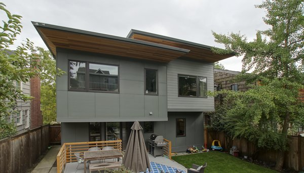 A new deck and connection to the exterior was created in order to take advantage of the new open plan. Photo 12 of Eave House modern home