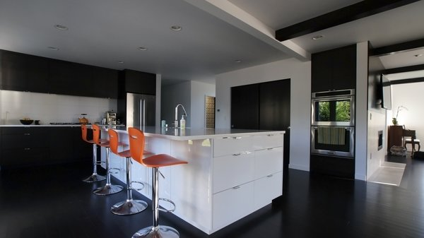 The majority of the kitchen is black and white but bright pops of color keep it modern and fresh. Photo 3 of Mod Remodel modern home