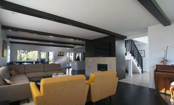 The open living room is both visually and functionally inviting by offering direct connections to the entry, stair, and kitchen beyond. Photo 6 of Mod Remodel modern home