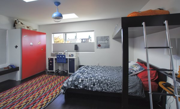 We designed the bedroom as a space where personality could shine through. The bright pops of color and fun details like the loft allow the room to be a form of expression. Photo 10 of Mod Remodel modern home