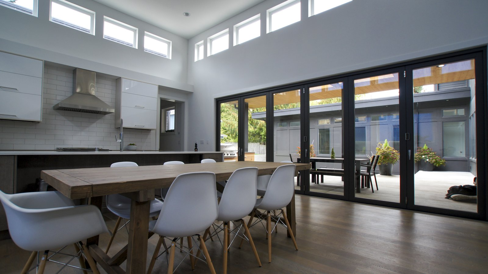 Natural light permeates the kitchen through the many windows and glass doors, brightening the room that often becomes the center of all activity for this family.