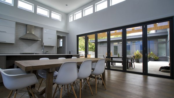 Natural light permeates the kitchen through the many windows and glass doors, brightening the room that often becomes the center of all activity for this family. Photo 4 of Modern Courtyard Home modern home