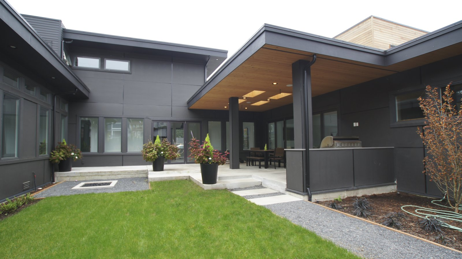The back of the house has an all grey exterior that lets the modern design speak for itself.