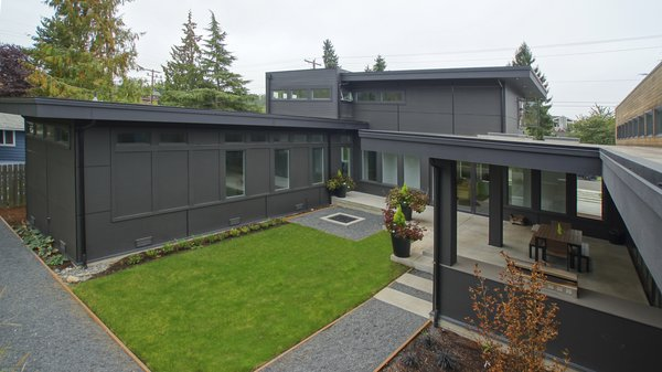 The backyard is designed to take advantage of the abundant space and allows for plenty of outdoor living throughout the year in the beautiful Pacific Northwest. Photo 12 of Modern Courtyard Home modern home