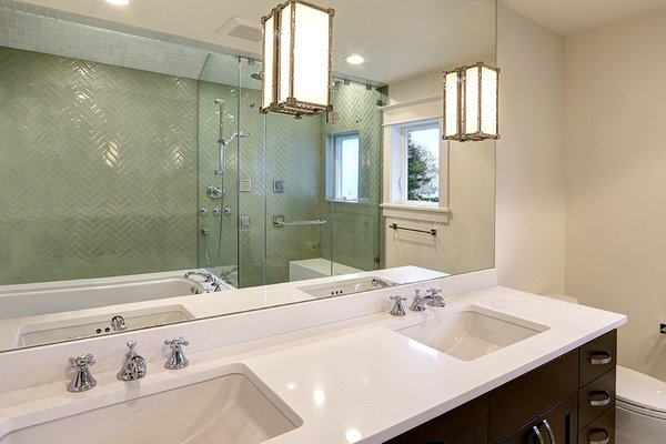 Modern home with bath room, soaking tub, recessed lighting, ceramic tile wall, wall lighting, and drop in sink. Photo 6 of West Seattle View Home