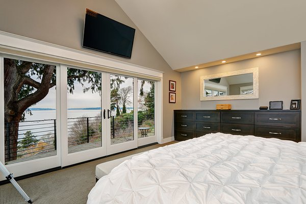 Modern home with bedroom, dresser, recessed lighting, carpet floor, and bed. Photo 7 of West Seattle View Home