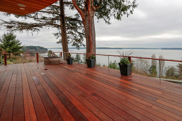 Modern home with outdoor, wood patio, porch, deck, decking patio, porch, deck, and front yard. Photo 8 of West Seattle View Home