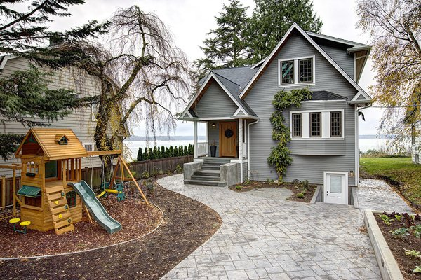 Modern home with outdoor, back yard, and pavers patio, porch, deck. Photo 9 of West Seattle View Home