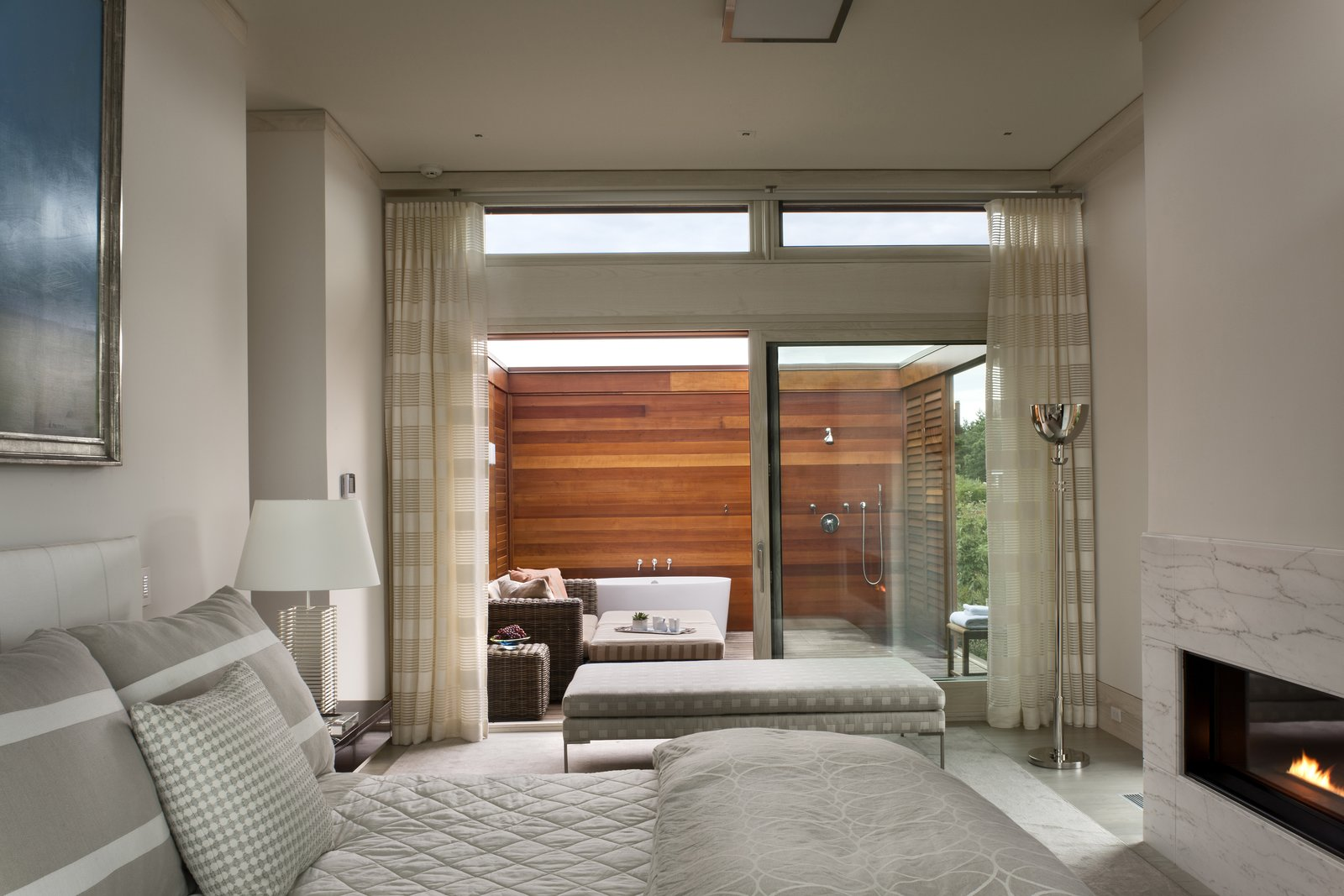 The master suite boasts two bathrooms, one of which is outside.  The Cape by Robert Paul Properties