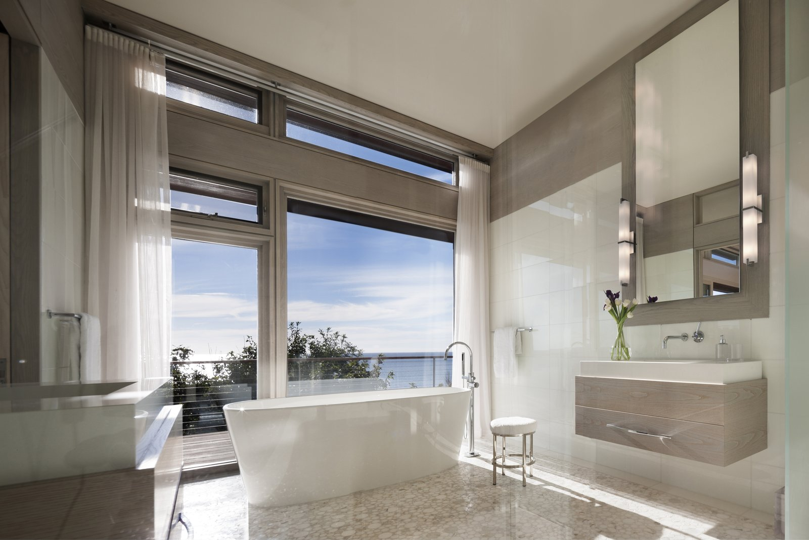 The master bathroom provides a place to escape and unwind.  The Cape by Robert Paul Properties