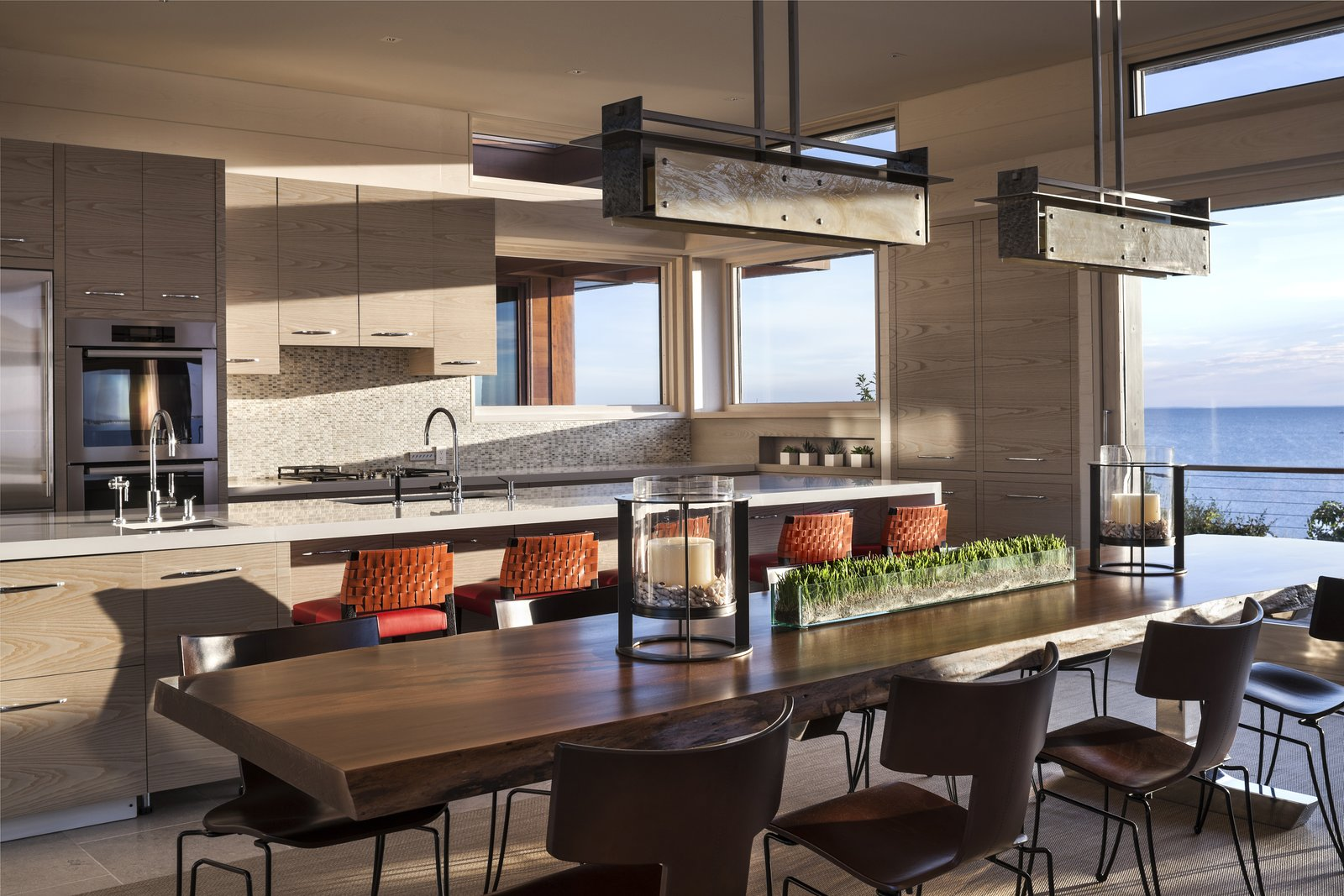 The open layout seamlessly connects kitchen, dining, and living spaces.