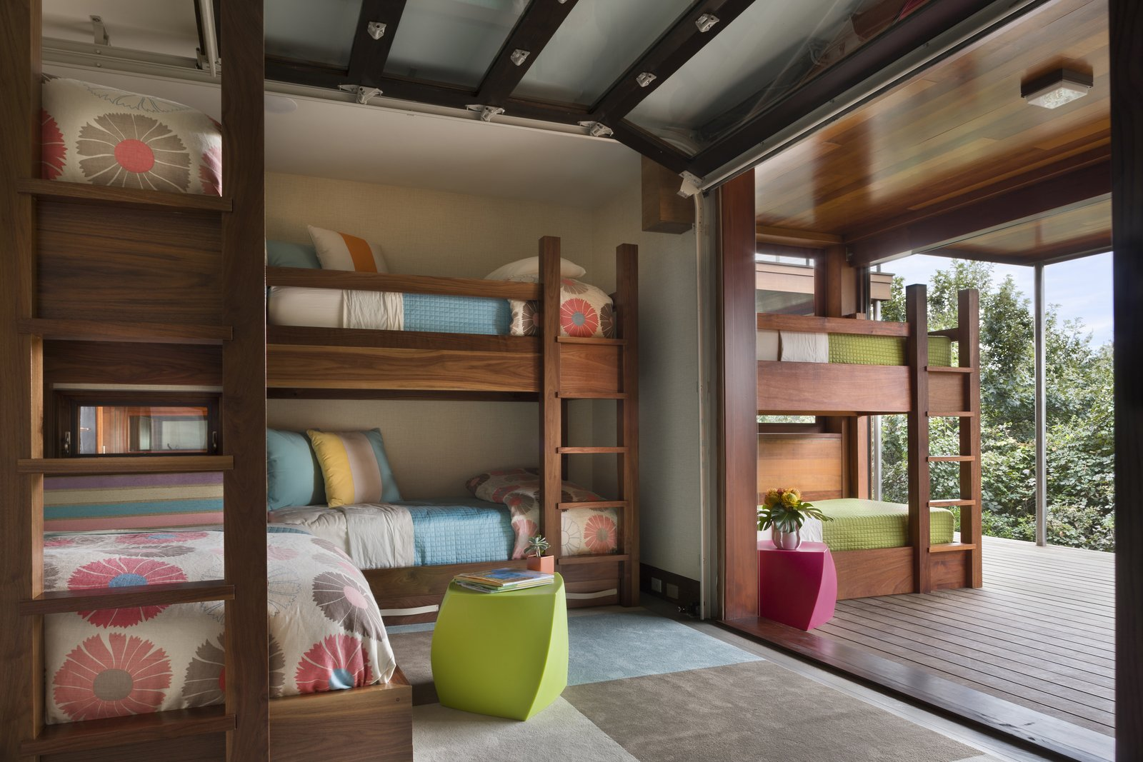 Garage-style doors open and connect the children's rooms to the outdoors.