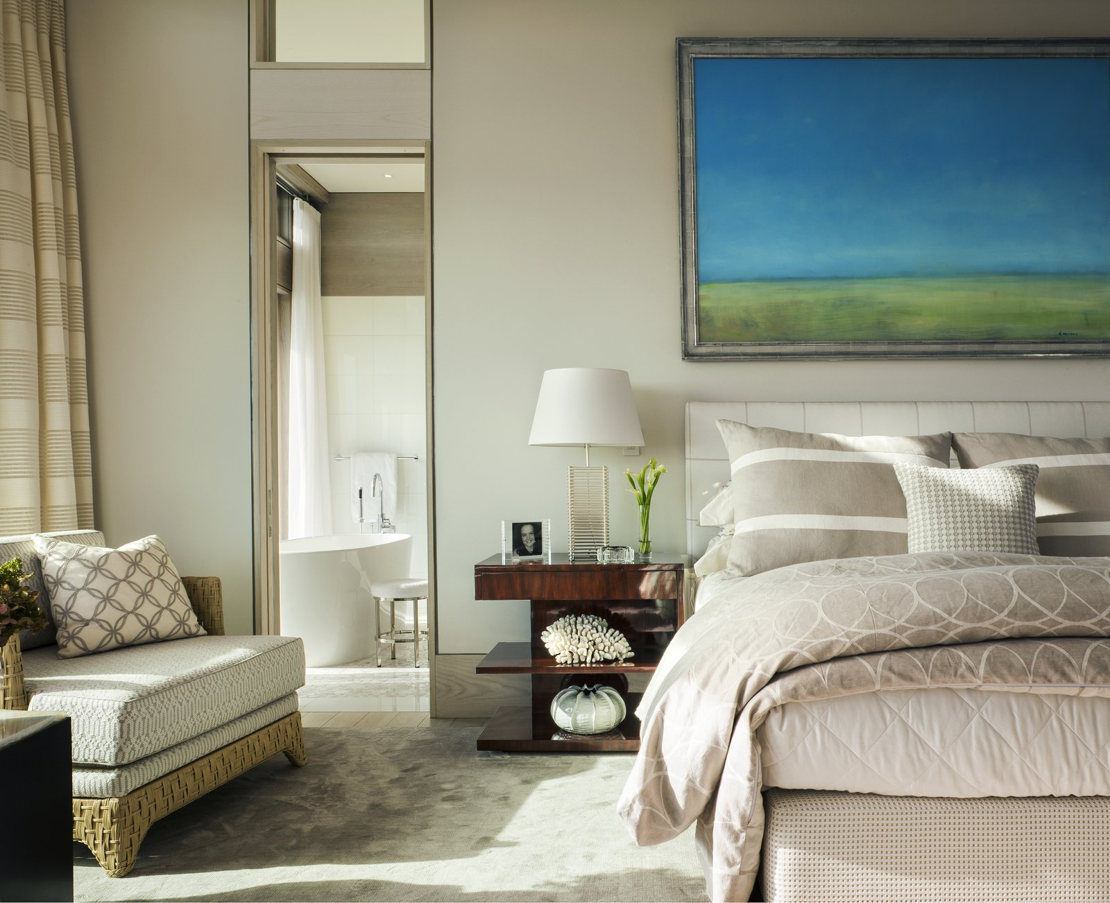 A sumptuous master suite located on the main floor.  The Cape by Robert Paul Properties