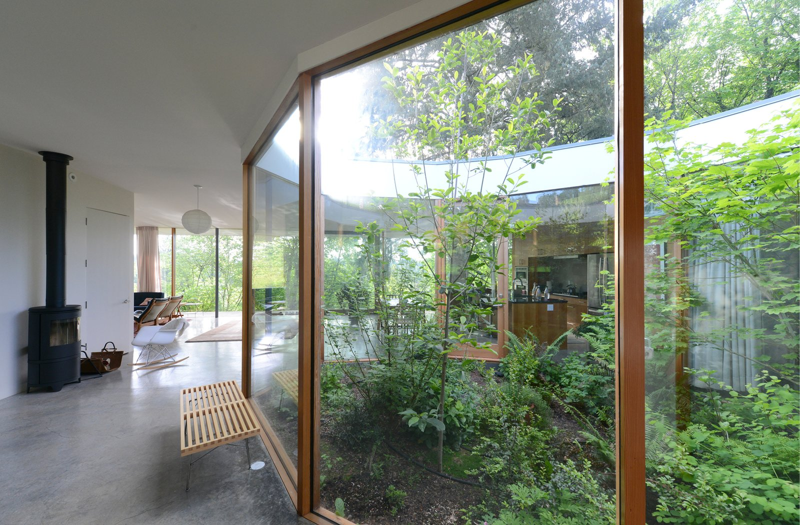 The faceted exterior glass courtyard introduces nature into daily life.   The Courtyard House by NO ARCHITECTURE