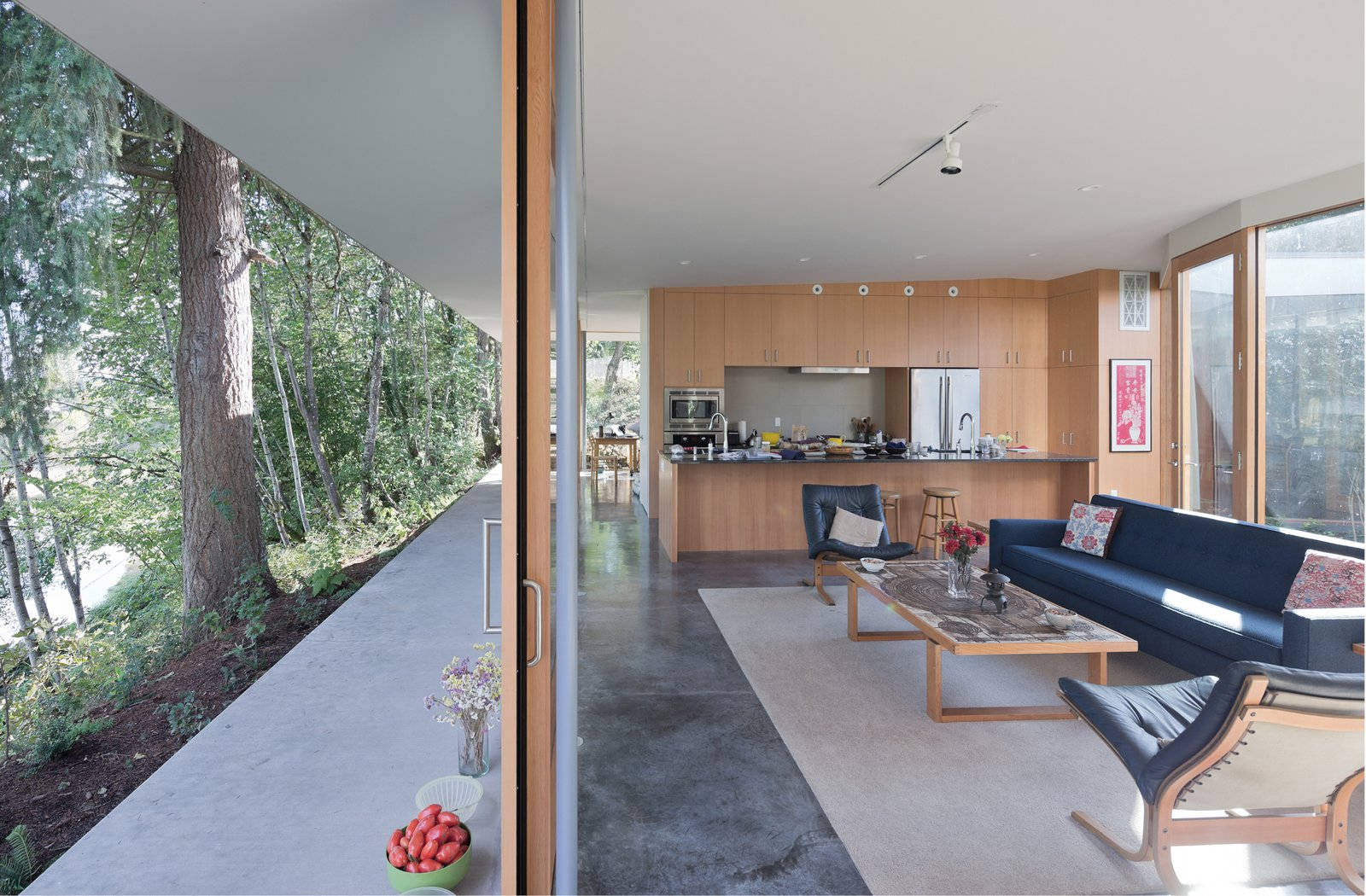 A matrix of rooms separate and connect around the L-shaped bathroom and storage cores made flexible by concealed doors at their ends.   The Courtyard House by NO ARCHITECTURE