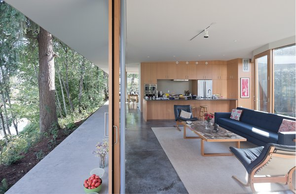 A matrix of rooms separate and connect around the L-shaped bathroom and storage cores made flexible by concealed doors at their ends.  Photo 10 of The Courtyard House modern home