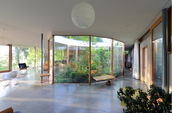 Because no room is compartmentalized and isolated as in a conventional home, every room can be an active space during the day and a sleeping space at night. Photo 11 of The Courtyard House modern home