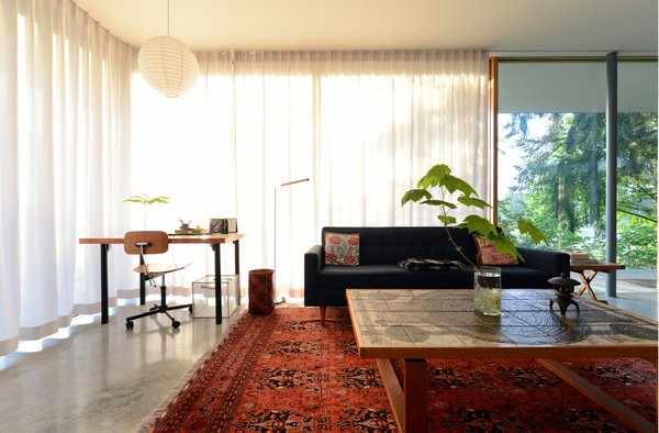 A continuous curtain track changes spaces from open to closed. Photo 13 of The Courtyard House modern home