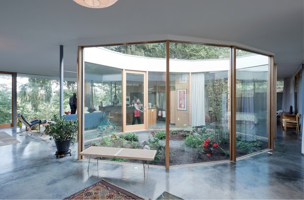 The Courtyard House nurtures inter-generational family life, framed by nature: a gentle entrance ramp and exterior covered terrace, negotiable for wheelchair, walker, or stroller, connects inside to out.  Photo 14 of The Courtyard House modern home