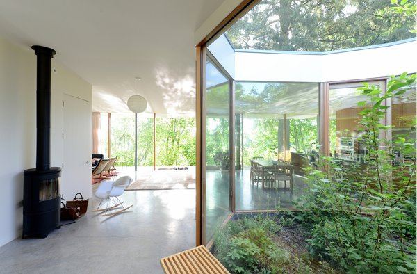 In the wintertime, the courtyard's position increases the passive heating of the sun, while in the summertime, shaded by native deciduous trees, the courtyard stimulates natural ventilation and passive cooling. Photo 16 of The Courtyard House modern home
