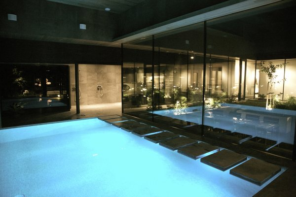 Calm and private sauna and pool area with view to the atrium Photo 4 of Karhusaari modern home