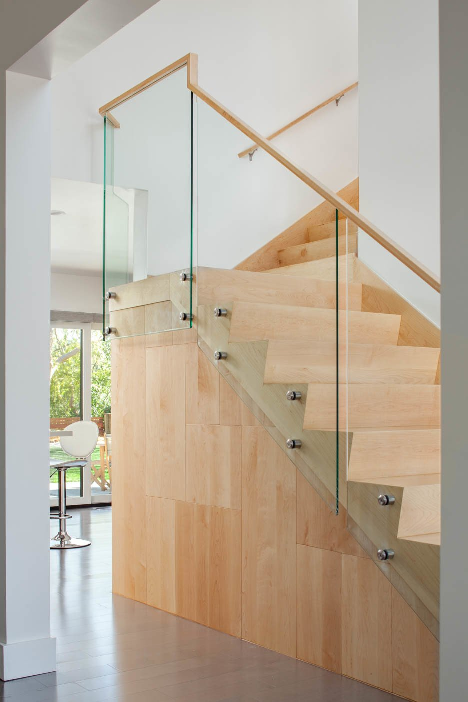 Custom maple wood and glass staircase