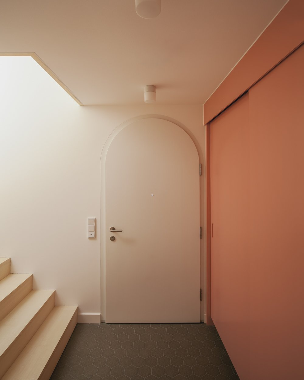 entree with pink wardrobe Tagged: Closet Storage Type, Staircase, and Wood Tread.  Haus Mai by Project Architecture Company