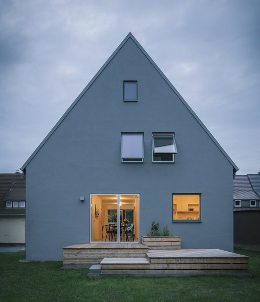 Modern home with outdoor, decking patio, porch, deck, back yard, wood patio, porch, deck, and garden. new garden facade Photo 7 of Haus Mai