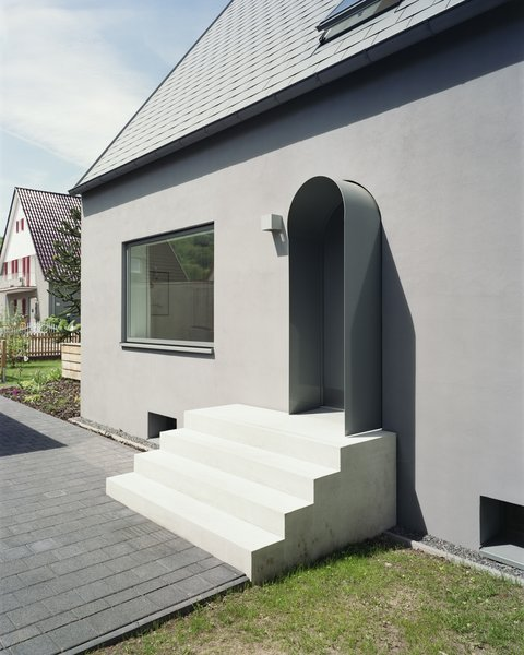 Modern home with concrete tread, doors, swing door type, exterior, and metal. entrance stair Photo 9 of Haus Mai