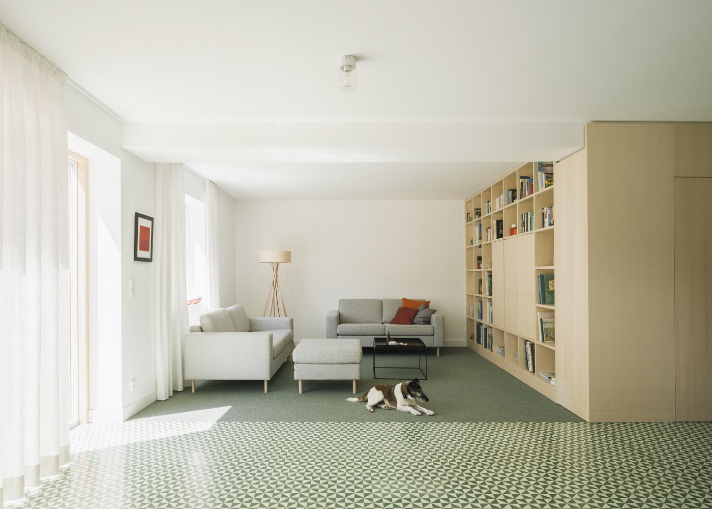 living room Tagged: Living Room, Shelves, Media Cabinet, Storage, Lamps, Bookcase, Sofa, and Cement Tile Floor.  Haus Mai by Project Architecture Company