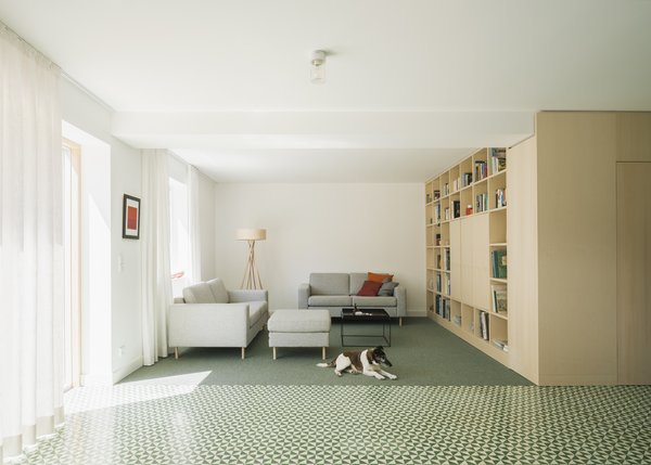 Modern home with living room, shelves, media cabinet, storage, lamps, bookcase, sofa, and cement tile floor. living room Photo 13 of Haus Mai