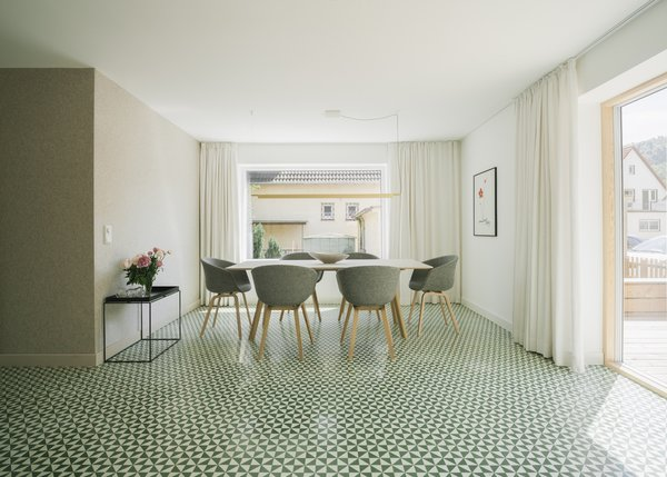 Modern home with dining room, chair, table, lamps, pendant lighting, and cement tile floor. dining table Photo 12 of Haus Mai
