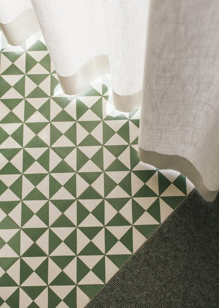 Modern home with living room, carpet floor, and cement tile floor. cement tiles Photo 17 of Haus Mai