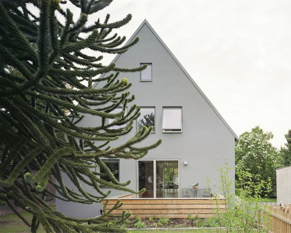Modern home with outdoor, front yard, wood patio, porch, deck, trees, decking patio, porch, deck, and garden. new street facade Photo 6 of Haus Mai