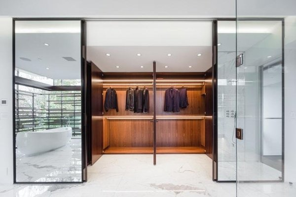 A walk in closet for your suits because you need six suits. Photo 9 of The Floating House modern home