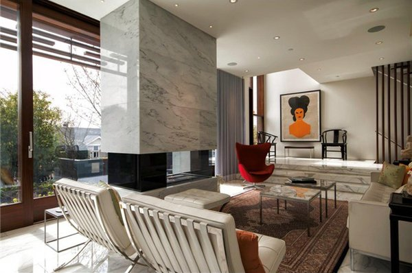 Living room again at a different angle with the fireplace visible  Photo 10 of The Floating House modern home