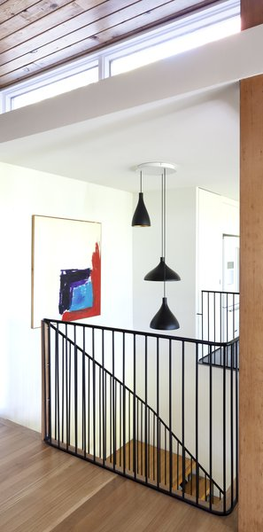 Modern home with wood tread, metal tread, metal railing, living room, pendant lighting, and ceiling lighting. Staircase - Rue de l'Espéranto residence  - Guillaume Sasseville & PARKA - Architecture & Design Photo 11 of Rue de l'Espéranto residence