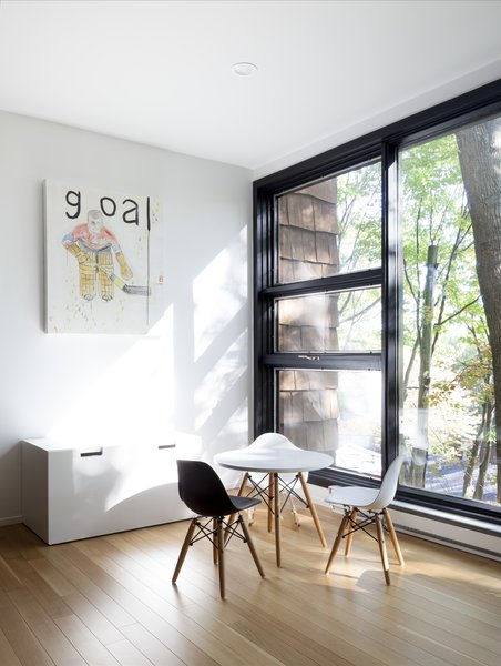 Modern home with playroom, chair, medium hardwood floor, light hardwood floor, teen age, pre-teen age, toddler age, neutral gender, and living room. Kids room - Rue de l'Espéranto residence  - Guillaume Sasseville & PARKA - Architecture & Design Photo 15 of Rue de l'Espéranto residence
