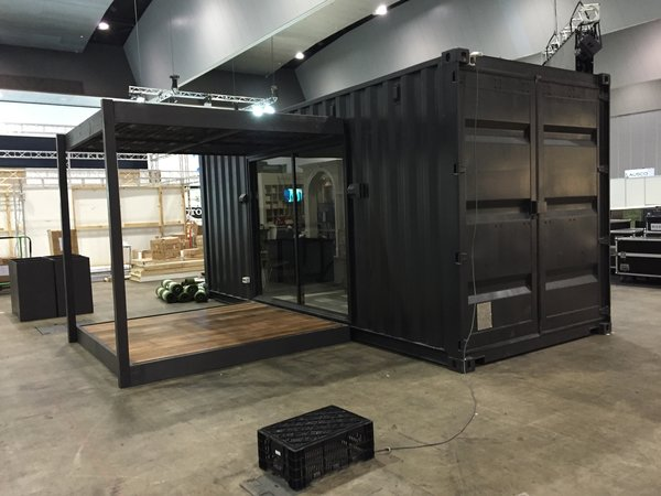 The SMALLisSMART Tiny House being set up at a building expo in Australia Photo  of The Tiny house modern home