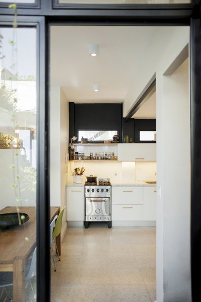 The kitchen seen from the patio. Photo 7 of Artigas modern home
