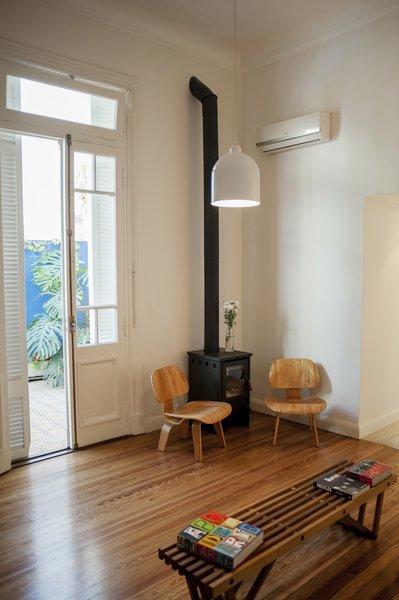 The living room preserves the original wooden floors and entrances Photo 8 of Artigas modern home