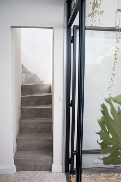 The stairs that used to be out in the patio are now inside thanks to the window and cealing that has been built after them. Photo 13 of Artigas modern home